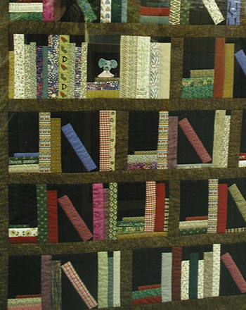"Library quilters Denise Griffin, Amy Johnson, Daksha Mistry, Karen Rodde, and Amy Ruyle's piece entitled ""Books in Print"""